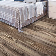 Solidtech flooring in bedroom | Hughes Floor Coverings Inc