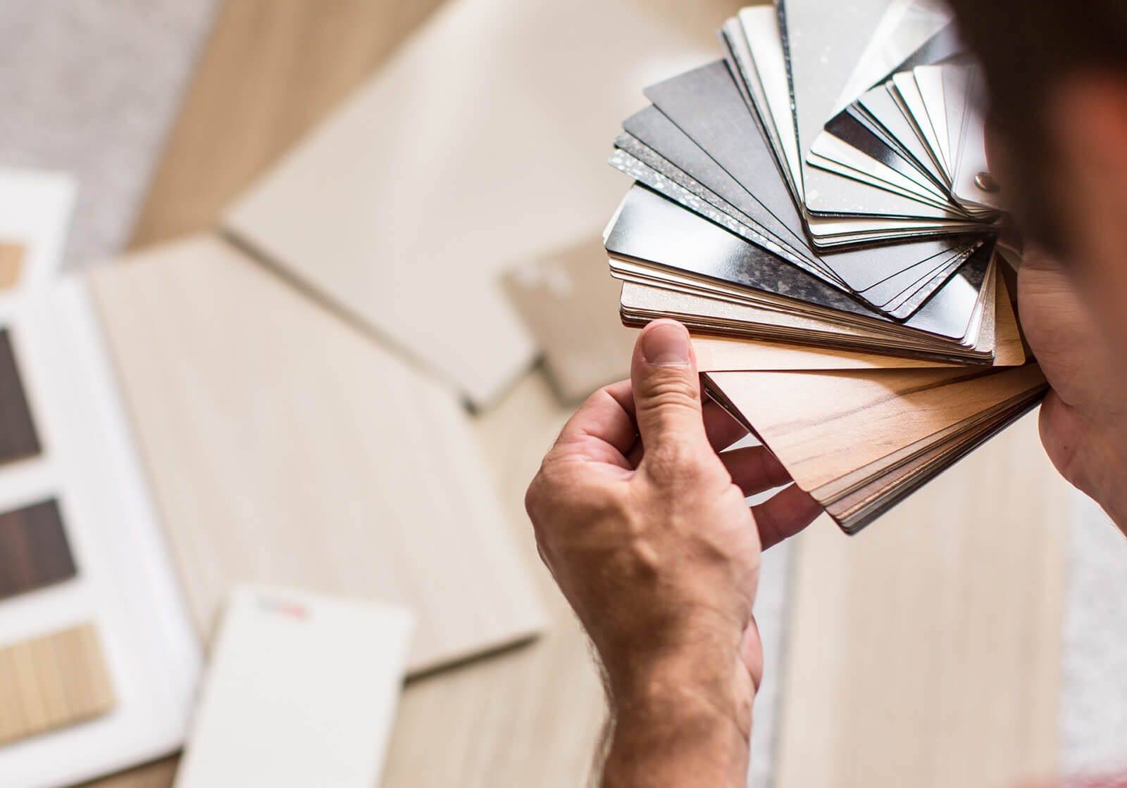 Comparing flooring samples | Hughes Floor Coverings Inc